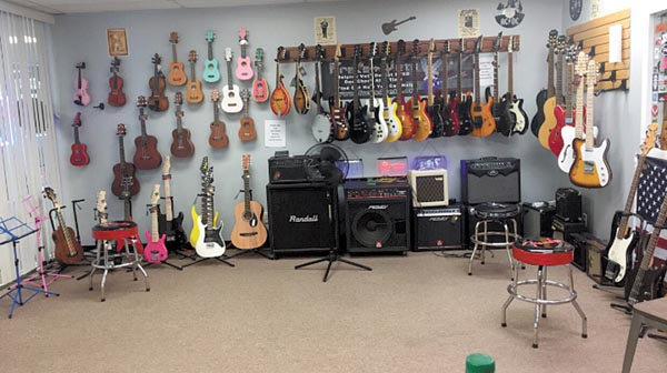 New Location for Shumaker Guitar Works in The Hilltop Campus Village